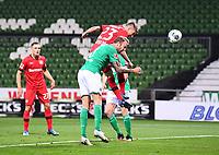 18th May 2020, WESERSTADION, Bremen, Germany; Bundesliga football, Werder Bremen versus Bayer Leverkusen; Goal scored for 1:3 by Mitchell Weiser (Leverkusen) climbing above the defender Kevin Vogt (Bremen).