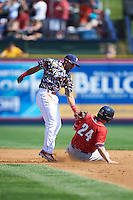Reading Fightin Phils second baseman Jesmuel Valentin (2) tags Matt Dean (24) sliding into second during a game against the New Hampshire Fisher Cats on June 6, 2016 at FirstEnergy Stadium in Reading, Pennsylvania.  Reading defeated New Hampshire 2-1.  (Mike Janes/Four Seam Images)