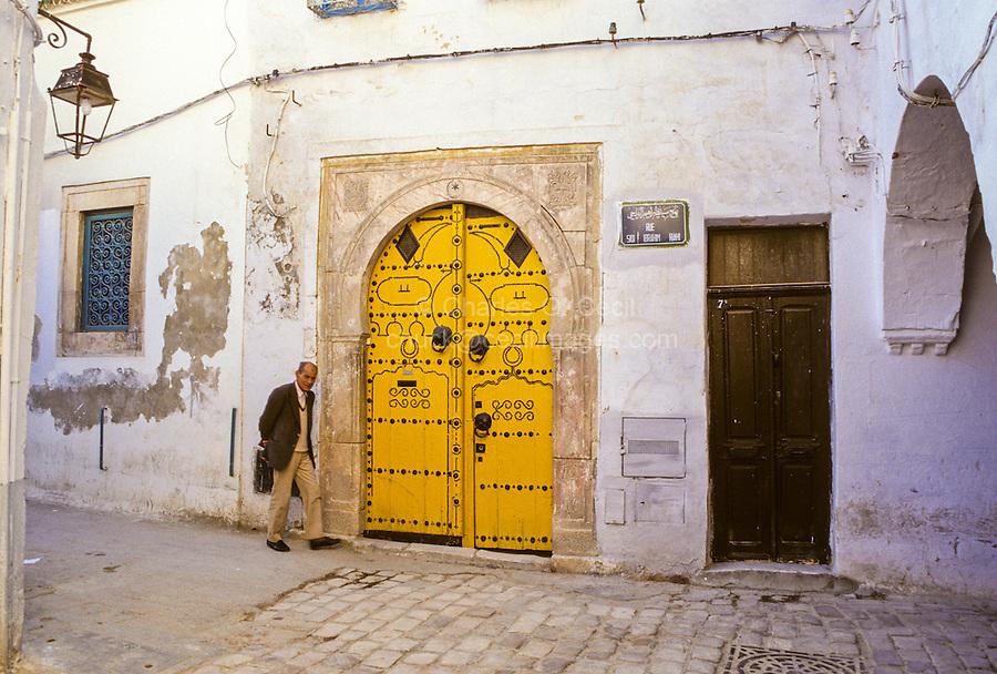 Tunisia.  Tunis Medina, Sidi Ibrahim Riahi Street.  Doorway.  The high door knockers date from the era when guests arrived on horseback.