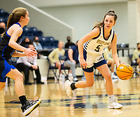 Ava Maner (23) of Rogers defending as Marybeth Dyson (5) of Bentonville West brings the ball up the court at Wolverine Arena, Centerton,  AR, Tuesday, January 12, 2021 / Special to NWA Democrat-Gazette/ David Beach