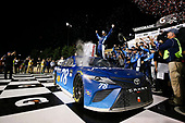 Monster Energy NASCAR Cup Series<br /> Go Bowling 400<br /> Kansas Speedway, Kansas City, KS USA<br /> Saturday 13 May 2017<br /> Martin Truex Jr, Furniture Row Racing, Auto-Owners Insurance Toyota Camry celebration<br /> World Copyright: Barry Cantrell<br /> LAT Images<br /> ref: Digital Image 17KAN1bc4835