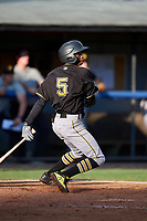 Bristol Pirates shortstop Victor Ngoepe (5) follows through on a swing during the first game of a doubleheader against the Bluefield Blue Jays on July 25, 2018 at Bowen Field in Bluefield, Virginia.  Bluefield defeated Bristol 6-3.  (Mike Janes/Four Seam Images)
