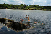 Amvrosiyivka, Ukraine.July 27, 2005 ..Children swim in the village lake....