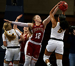 SIOUX FALLS, SD - MARCH 7: Claire Gritt #12 of the Denver Pioneers blocks the shot attempt of Ryan Cobbins #5 of the North Dakota State Bison during the Summit League Basketball Tournament at the Sanford Pentagon in Sioux Falls, SD. (Photo by Dave Eggen/Inertia)