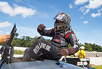 Aug 21, 2016; Brainerd, MN, USA; NHRA  top alcohol funny car driver Jonnie Lindberg celebrates after winning the Lucas Oil Nationals at Brainerd International Raceway. Mandatory Credit: Mark J. Rebilas-USA TODAY Sports