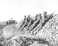A U.S. Infantry anti-tank crew fires on Nazis who machine-gunned their vehicle, somewhere in Holland.  November 4, 1944.  W. F. Stickle.  (Army)<br /> NARA FILE #:  111-SC-197367<br /> WAR & CONFLICT BOOK #:  1068