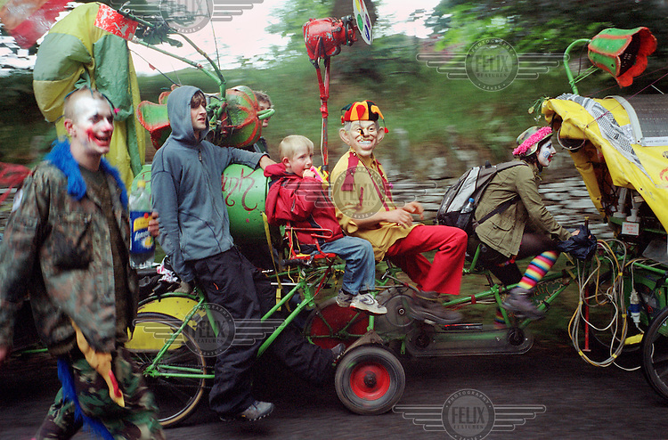 Protestors, dressed as clowns, from the Clandestine Insurgent Rebel Clown Army (CIRCA) return with Rinky Dink (another activist group) to HQ after attending demonstrations during the G8 summit.