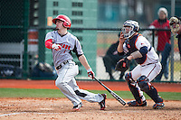 Trey Stover (7) of the Hartford Hawks follows through on his swing against the Virginia Cavaliers at The Ripken Experience on February 27, 2015 in Myrtle Beach, South Carolina.  The Cavaliers defeated the Hawks 5-1.  (Brian Westerholt/Four Seam Images)