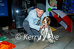 Alex Moore from Cullen, Co Cork with his dog Milly Moore busking in Killarney on Saturday night.