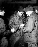 One of the first men to receive baseball star Joe Dimaggio's autograph when he visited this advanced air base in Korea on November 1st, 1950, was Sgt John Mosakowski, Newark, NY.  <br /> <br /> Mosakowski is with the 6150th Tactical Support Wing, which took over operation of this former North Korean Air Base.