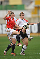 Heather O'Reilly vs a Norwegian defender during the Algarve Cup 2010.