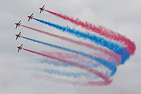 The Red Arrows perform during the Swansea Airshow 2019 over Swansea Bay, Wales, UK.