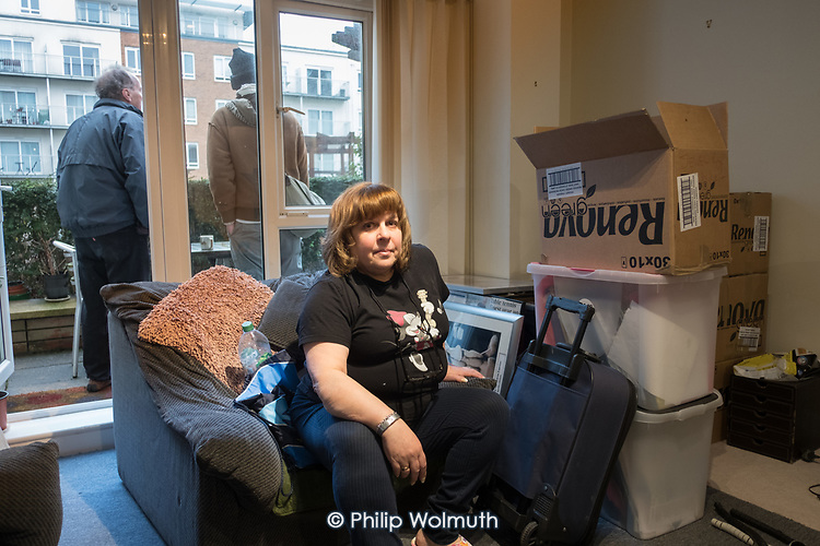 Carolyn Mandelson waits for the bailiffs on the day of her eviction from her Genesis Housing shared ownership flat in Beaufort Park, London Borough of Barnet, following legal action by Barclays Bank.
