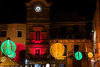 Italy. Apulia Region. Cisternino. Night time. Christmas decoration. Colorful bulbs made out of handmade embroided fabrics. Cisternino is town and a comune. In 2014, Cisternino was declared the cittaslow city of the year. Cittaslow is an organisation founded in Italy and inspired by the slow food movement. Cittaslow's goals include improving the quality of life in towns by slowing down its overall pace, especially in a city's use of spaces and the flow of life and traffic through them. Cittaslow is part of a cultural trend known as the slow movement. Apulia (Puglia) is a region in Southern Italy. 6.12.18  © 2018 Didier Ruef