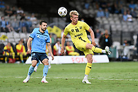 8th February 2021; Jubilee Stadium, Sydney, New South Wales, Australia; A League Football, Sydney Football Club versus Wellington Phoenix; James McGarry of Wellington Phoenix slices his clearance as Kosta Barbarouses of Sydney watches on