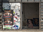Abandoned shop, pasted posters, Along the historic streets of Veliko Tarnovo, Bulgaria