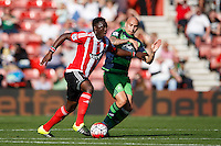 Victor Wanyama and Jonjo Shelvey during the Barclays Premier League match between Southampton v Swansea City played at St Mary's Stadium, Southampton