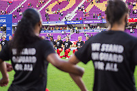 ORLANDO, FL - FEBRUARY 21: CANWNT kneels before the anthem before a game between Argentina and Canada at Exploria Stadium on February 21, 2021 in Orlando, Florida.