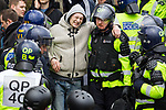 © Joel Goodman - 07973 332324 - all rights reserved . 05/02/2011 . Luton , UK . An injured EDL supporter is assisted by police . The English Defence League ( EDL ) hold a march and demonstration against Islamic fundamentalism in Luton . Photo credit : Joel Goodman