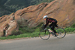 Woman cyclist in Red Rocks State Park, Colorado