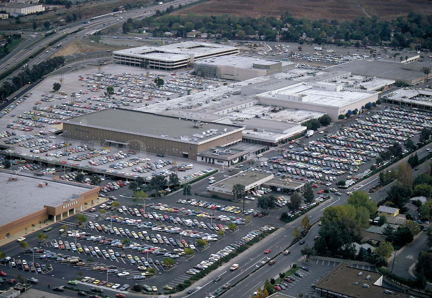 urban area, highway, parking lot, vehicle, automobiles, shopping district, stores. urban development. California.