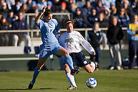 Notre Dame Fighting Irish midfielder Courtney Rosen (14) is marked by North Carolina Tar Heels midfielder Yael Averbuch (17). The North Carolina Tar Heels defeated the Notre Dame Fighting Irish 2-1 during the finals of the NCAA Women's College Cup at Wakemed Soccer Park in Cary, NC, on December 7, 2008. Photo by Howard C. Smith/isiphotos.com