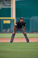 Third base umpire Edwin Moscoso  handles the calls on the bases during the game between the Reno Aces and the Nashville Sounds at Greater Nevada Field on June 5, 2019 in Reno, Nevada. The Aces defeated the Sounds 3-2. (Stephen Smith/Four Seam Images)
