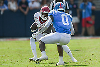 *Arkansas running back Trelon Smith (22) carries the ball as Ole Miss linebacker Lakia Henry (0) blocks, Saturday, October 9, 2021 during the fourth quarter of a football game at Vaught Hemingway Stadium in Oxford, Miss. Check out nwaonline.com/211010Daily/ for today's photo gallery. <br /> (NWA Democrat-Gazette/Charlie Kaijo)
