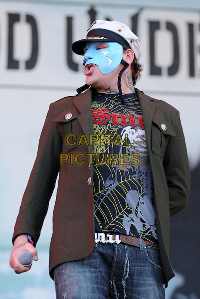 HOLLYWOOD UNDEAD.Download Festival 2009 - Day One.Donington Park, Derbyshire, England..June 12th, 2009.stage concert live gig performing performance music half length mask  black top green jacket baseball cap hat .CAP/BRC.©Ben Rector/Capital Pictures.