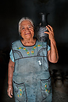 Crispina, Ceramic Potter, Oaxaca, Mexico, 2019<br /> Crispina Lopez Garcia, age 72, makes traditional black pottery in a small studio in back of her home. She learned this from her mother, and it's been passed on for generations. Each pot is made by hand. She is a widow; sometimes her son helps her, but he's mostly away, working in the city. With a small loan from an international nonprofit, Pro Mujer, Crispina was able to buy more supplies and grow her business.