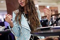 Diana Basfam, student at the International University of Monaco, drinks coffee in Lina's Café in the Métropole Shopping Centre, Monte Carlo, Monaco, 19 April 2013