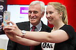 © Joel Goodman - 07973 332324 . 28/09/2016 . Liverpool , UK . JOHN MCDONNELL poses for a selfie with a supporter during a tour of the exhibition during the final day of the Labour Party Conference at the ACC in Liverpool . Photo credit : Joel Goodman