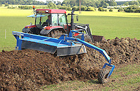 The compost winrow turner in action.