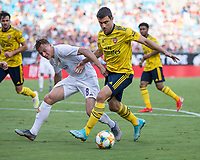 CHARLOTTE, NC - JULY 20: Szymon Zurkovski #8 attacks with Sokratis Papastathopoulos #5 defending during a game between ACF Fiorentina and Arsenal at Bank of America Stadium on July 20, 2019 in Charlotte, North Carolina.