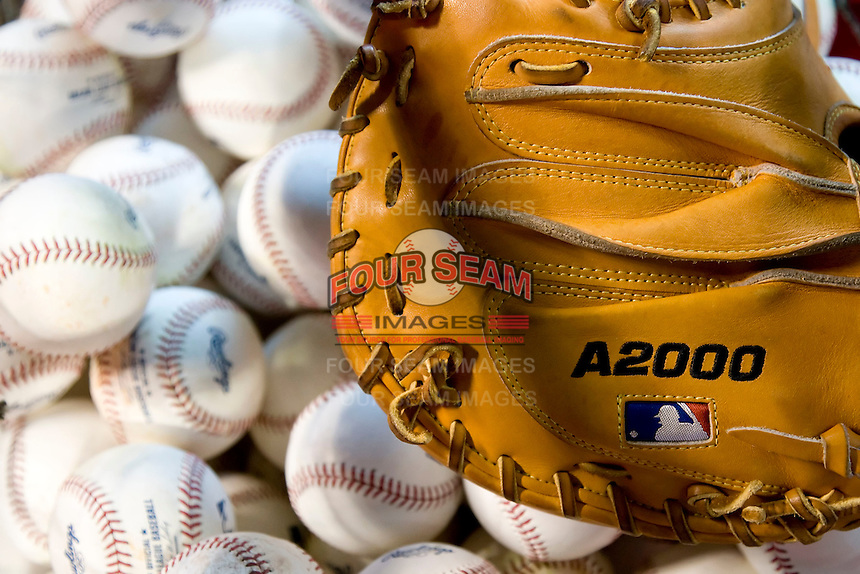 Major league baseballs and glove (Andrew Woolley/Four Seam Images)