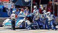 #01 Ford Riley, Scott Pruett, Memo Rojas, Scott Dixon, pit stop, Petit Le Mans , Road Atlanta, Braselton, GA, October 2014.   (Photo by Brian Cleary/www.bcpix.com)