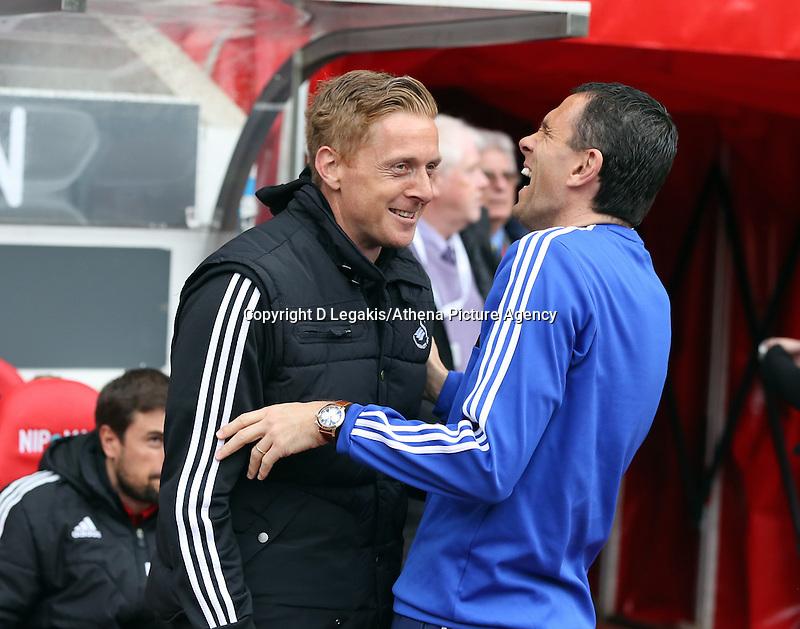 Pictured L-R: Swansea manager Garry Monk shares a joke with Sunderland manager Gus Poyet. Sunday 11 May 2014<br /> Re: Barclay's Premier League, Sunderland v Swansea City FC at the Stadium of Light, Sunderland, UK.