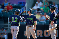 Vermont Lake Monsters Marty Bechina (10) and Kyle McCann (33) congratulate Jordan Diaz (12) after a home run during a NY-Penn League game against the Aberdeen IronBirds on August 18, 2019 at Leidos Field at Ripken Stadium in Aberdeen, Maryland.  Vermont defeated Aberdeen 6-5.  (Mike Janes/Four Seam Images)