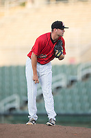 Kannapolis Intimidators relief pitcher Mike Morrison (28) looks to his catcher for the sign against the Greensboro Grasshoppers at Intimidators Stadium on July 17, 2016 in Greensboro, North Carolina.  The Grasshoppers defeated the Intimidators 5-4 in game two of a double-header.  (Brian Westerholt/Four Seam Images)