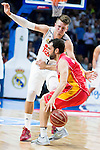 Real Madrid's player Luka Doncic and UCAM Murcia's player Benite during the third match of the Liga Endesa Playoff at Barclaycard Center in Madrid. May 31. 2016. (ALTERPHOTOS/Borja B.Hojas)