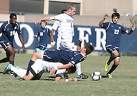 Ian Christianson #6 of Georgetwn University clears the ball as Sean Margenthal #12 of Villanova University falls over Tommy Muller #8 during a Big East match at North Kehoe Field, Georgetown University on October16 2010 in Washington D.C. Georgetown won 3-1.