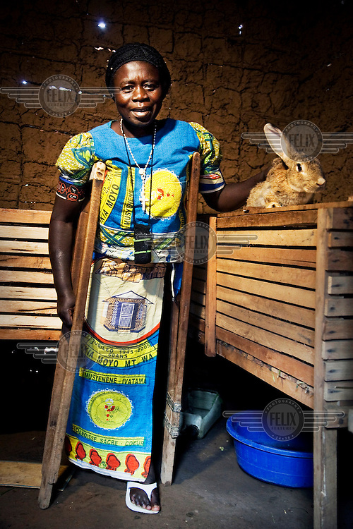 Emilie, who has lost a leg, fled from the war in eastern Congo. By raising and selling rabbits she earns an income for her family.