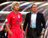 Chun Soo Lee (14) and coach Dick Advocaat of the Korea Republic.The Korea Republic and France played to a 1-1 tie in their FIFA World Cup Group G match at the Zentralstadion, Leipzig, Germany, June 18, 2006.