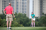 Gary McAllister watches while Cindy Lee plays during the World Celebrity Pro-Am 2016 Mission Hills China Golf Tournament on 23 October 2016, in Haikou, Hainan province, China. Photo by Weixiang Lim / Power Sport Images