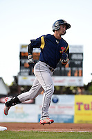 State College Spikes outfielder Jhohan Acevedo (13) runs the bases after hitting a lead off home run during a game against the Batavia Muckdogs on June 22, 2014 at Dwyer Stadium in Batavia, New York.  State College defeated Batavia 10-3.  (Mike Janes/Four Seam Images)