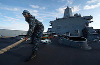 130501-N-DR144-014 COOK INLET, Alaska (May 1, 2013)- Sailors heave around lines as San Antonio-class amphibious transport dock ship USS Anchorage (LPD 23) moors at the Port of Anchorage. Anchorage arrived at its namesake city of Anchorage, Alaska for its commissioning ceremony scheduled to take place May 4. (U.S. Navy photo by Mass Communication Specialist 1st Class James R. Evans / RELEASED)