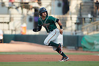 Nick Gonzales (2) of the Greensboro Grasshoppers takes off for second base against the Winston-Salem Dash at Truist Stadium on August 13, 2021 in Winston-Salem, North Carolina. (Brian Westerholt/Four Seam Images)