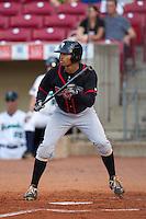 Lansing Lugnuts outfielder Dalton Pompey #15 bats during a game against the Cedar Rapids Kernels at Veterans Memorial Stadium on April 29, 2013 in Cedar Rapids, Iowa. (Brace Hemmelgarn/Four Seam Images)