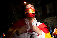 MADRID, SPAIN – MAY 04: A woman who wears a Spanish flag as a cape and a mask with the Spanish flag, celebrates the victory of the PP in front of its headquarters on 4 May in Madrid, Spain.(Photo by Joan Amengual / VIEWpress via Getty Images)
