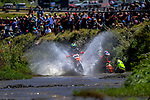 James Galpin passes the stranded Melissa Adger in River Race one. 2021 New Zealand Motocross Grand Prix at Old Gorge Road in Woodville , New Zealand on Sunday, 31  January 2021. Photo: Dave Lintott / lintottphoto.co.nz